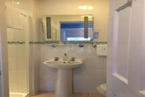 Single room bathroom.