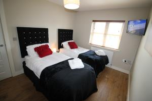 Bedroom 2 with wall-mounted TV